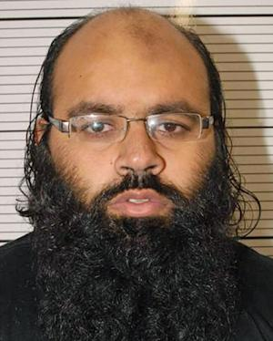 In this undated image released by West Midlands Police showing Irfan Naseer from Birmingham, who was found guilty at court in London and sentenced Friday April 26, 2013, to life imprisonment with no possibility of parole for at least 18-years. Naseer, the ringleader of an al-Qaida-inspired plot to detonate knapsack bombs in England was sentenced Friday, along with nine accomplices. (AP Photo/West Midlands Police) NO SALES