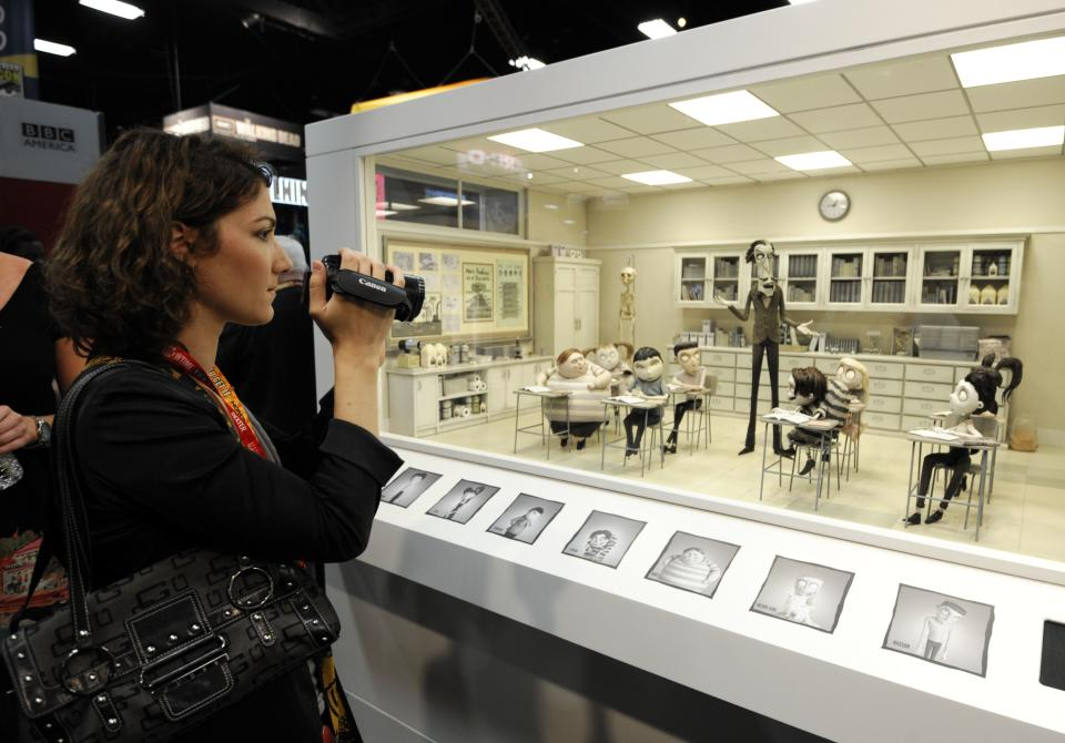 "A photographer shoots into the set of of the Disney Tim Burton movie ""Frankenweenie"" on display at Comic-Con preview night held at the San Diego Convention Center on Wednesday July 11, 2012, in San Diego.  (Photo by Denis Poroy/Invision/AP)"
