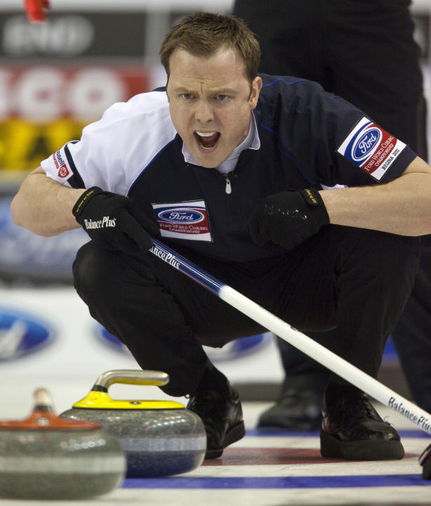 Scottish skip Tom Brewster encourages his sweepers during the gold medal game against Canada at the Ford World Men's Curling Championships in Regina, Saskatchewan, April 10, 2011.  AFP PHOTO/Geoff Rob