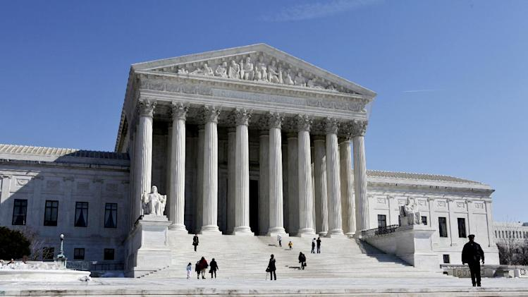 FILE- This March 5, 2009, file photo shows the U.S. Supreme Court building in Washington. The Supreme Court will struggle this week with the validity of an Arizona law that tries to keep illegal immigrants from voting by demanding all state residents show documents proving their U.S. citizenship before registering to vote in national elections.  (AP Photo/J. Scott Applewhite, File)
