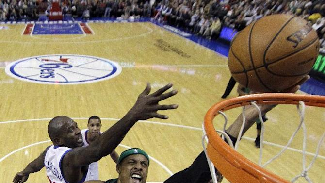 Boston Celtics' Paul Pierce, center, goes up for a shot against Philadelphia 76ers' Jason Richardson, left, in the first half of an NBA basketball game, Friday, Dec. 7, 2012, in Philadelphia. (AP Photo/Matt Slocum)