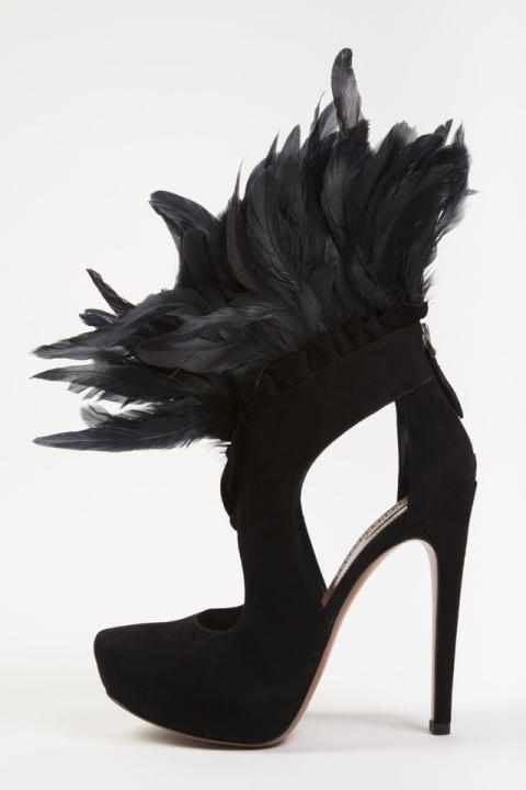 "In this undated photo provided by the Fashion Institute of Technology, shows a shoe decorated with feathers and designed by Azzedine Alaia. The shoe is on display at the ""Shoe Obsession"" exhibit at Th"