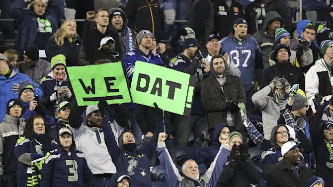 "Seattle Seahawks fans celebrate with a variation on the New Orleans Saints slogan ""Who Dat?"" in the second half of an NFL football game, Monday, Dec. 2, 2013, in Seattle. The Seahawks beat the Saints 34-7"
