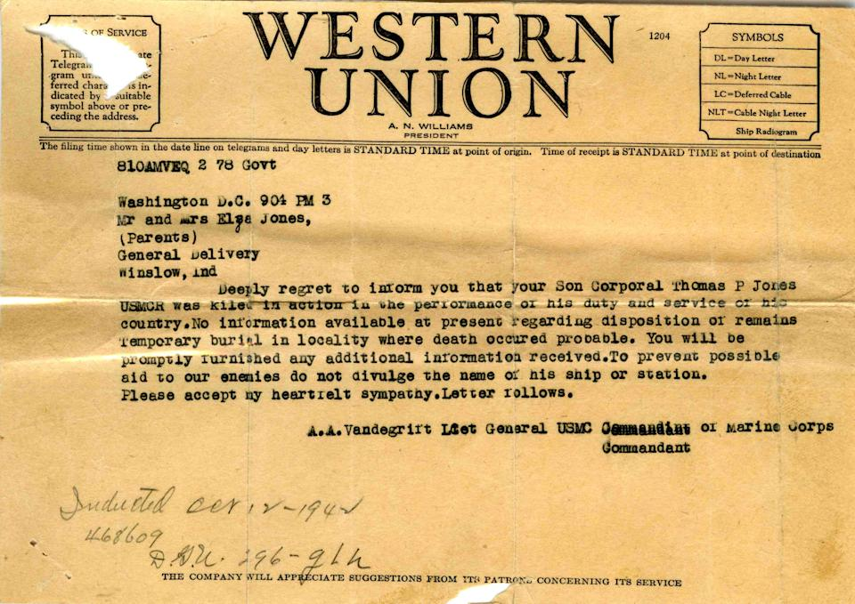 "This photo provided by the National WWII Museum shows a telegram notifying his parents of the death of their son, 22-year-old Marine Cpl. Thomas ""Cotton"" Jones, who died in the bloody assault on a Japanese-held island during World War II. (AP Photo/National WWII Museum)"