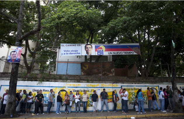 Residents  line up at a polling station to vote in presidential elections in Caracas, Venezuela, Sunday, Oct. 7, 2012. President Hugo Chavez is running against opposition candidate Henrique Capriles.(