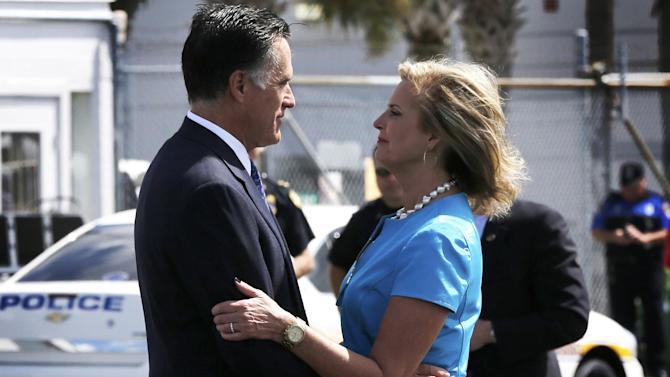Republican presidential candidate, former Massachusetts Gov. Mitt Romney, embraces his wife Ann before he boards his campaign charter plane in Jacksonville, Fla.,  Wednesday, Sept. 12, 2012. (AP Photo/Charles Dharapak)