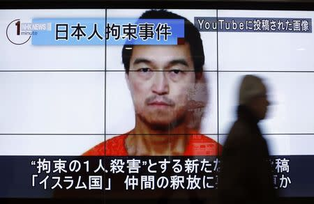 Japan vows to work with Jordan to secure hostage release