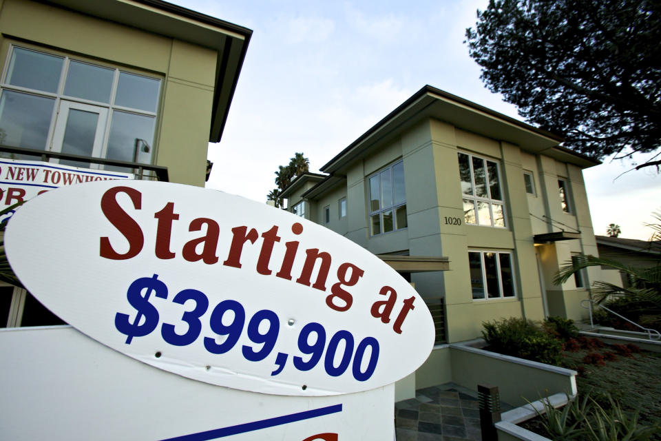 Newly built luxury townhomes are offered for sale in Woodland Hills, Calif. Tuesday, Jan. 10, 2012. Fixed mortgage rates hit yet another record low on the second week of the new year. But the cheap rates are expected to do little to boost the depressed housing market. (AP Photo/Damian Dovarganes)