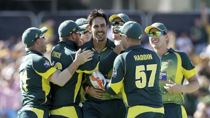 Australia's Mitchell Johnson celebrates with team mates after taking the wicket of England's Eoin Morgan during their One Day International tri-series cricket final match at the WACA ground