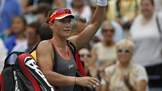 Samantha Stosur waves to the crowd as she leaves following her defeat to Victoria Azarenka in their women&#39;s singles quarter-final at the US Open (Reuters)