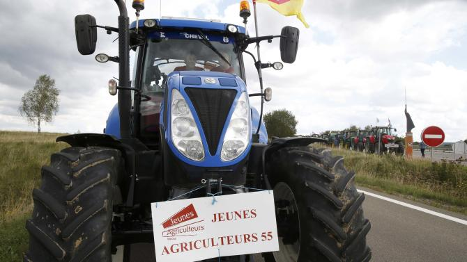 French farmers from Lorraine region drive their tractors on the A4 motorway in the Champagne-Ardenne region, eastern France