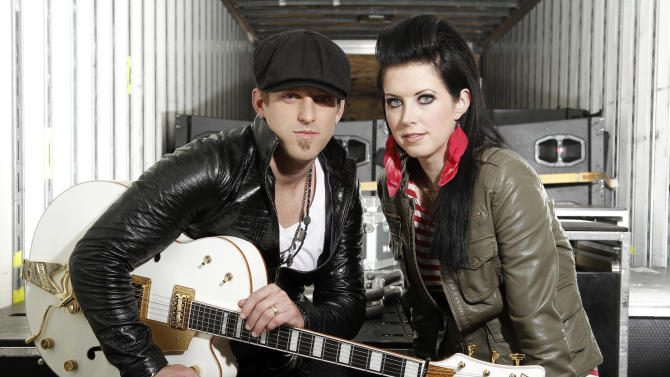 In this Oct. 27, 2011 photo, musicians Keifer Thompson, left, and Shawna Thompson, of the group Thompson Square, pose for a portrait in Los Angeles. The husband-wife team have been on tour with Jason Aldean, are headed out with Lady Antebellum, and have received a slew of award nominations, including in the competitive new artist of the year category at next week's Country Music Association Awards. (AP Photo/Matt Sayles)