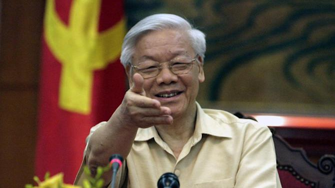 """FILE - In this July 3, 2015 file photo, Vietnamese Communist Party General Secretary Nguyen Phu Trong gestures during a meeting with the Western press in Hanoi, Vietnam. Trong doesn't hold an official government post, but it's not surprising that he'll meet with U.S. President Barack Obama on his visit to the United States. Trong called his trip on Tuesday, July 7, 2015 """"a historic visit."""" He said he expects Obama to make his first visit to Vietnam later this year, though the White House has not confirmed the trip. (AP Photo/Tran Van Minh, File)"""