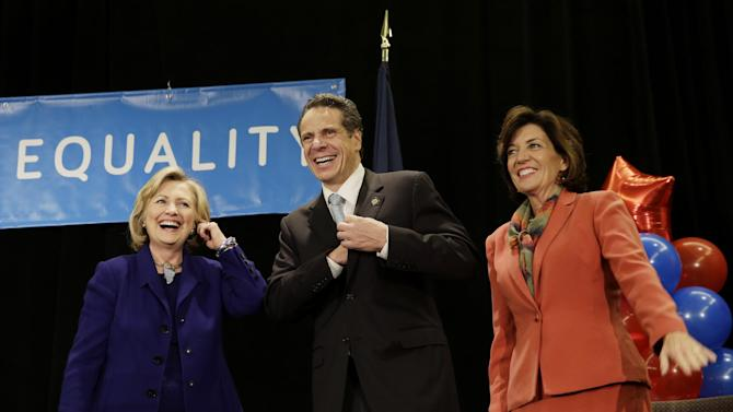 "Former Secretary of State Hillary Rodham Clinton, left, New York Governor Andrew Cuomo and Lt. Governor nominee Kathy Hochul laugh on stage during a ""Women for Cuomo"" campaign event in New York, Thursday, Oct. 23, 2014. Mrs Clinton is backing Cuomo in his bid for a second term. Cuomo faces Republican Westchester County Executive Rob Astorino in the Nov. 4 general election. (AP Photo/Seth Wenig)"