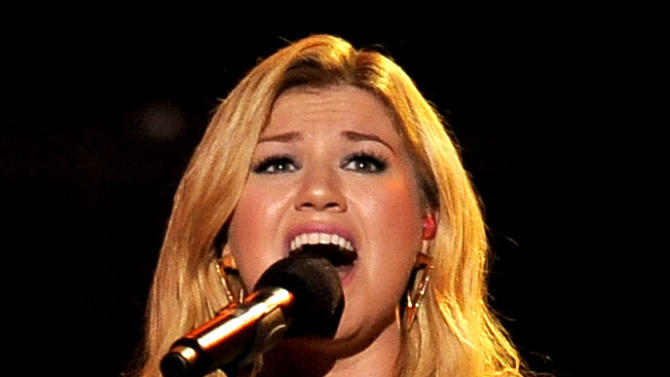 """FILE - In this Dec. 16, 2012 file photo, Kelly Clarkson performs at VH1 Divas at the Shrine Auditorium in Los Angeles. Kelly Clarkson's No. 1 hit, """"Stronger (What Doesn't Kill You),"""" is nominated for record of the year at Grammy Awards on Feb. 10, 2013. The song is also up for song of the year and best pop solo performance, and her fifth album, """"Stronger,"""" is nominated for best pop vocal album. (Photo by Chris Pizzello/Invision/AP, File)"""