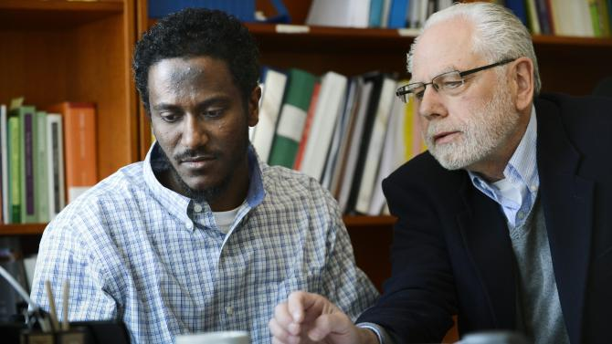 Yonas Fikre, left, a Portland, Oregon Muslim American talks to media with his attorney, Thomas Nelson, in Stockholm, Sweden, April 18, 2012. After a 2010 trip to visit family in Khartoum, Sudan,  Fikre claims to have been detained and tortured. Put on a FBI no-fly list,  Fikre is now unable to return home to the U.S. (AP Photo / Claudio Bresciani)