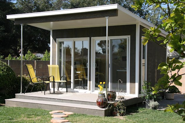In this undated publicity photo provided by Cabin Fever, a prefabricated cabin is used as a backyard artist studio as shown in Pasadena, Calif. The Zip model by Cabin Fever in Miami, Fla. comes flat-packed and can be assembled in just a few days. (AP Photo/Cabin FeverGayle Zalduondo)