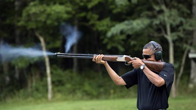 FILE - In this Aug. 4, 2012 file photo released by the White House, President Barack Obama shoots clay targets on the range at Camp David, Md. Obama will pitch his proposals to stem gun violence Monday, Feb. 4, 2013 in Minnesota, a Democratic-leaning state where officials have been studying ways to reduce gun-related incidents for several years. (AP Photo/The White House, Pete Souza)