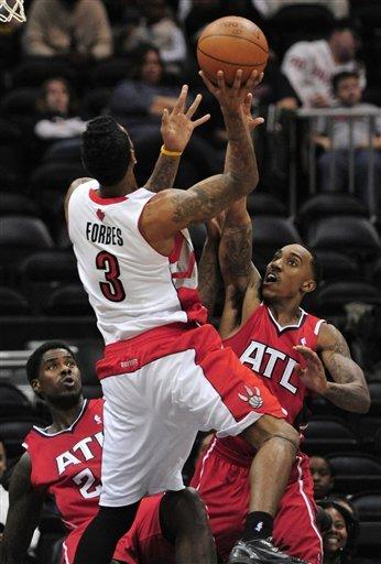 Smith, Johnson push Hawks past Raptors 93-84