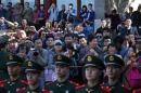 Paramilitary policemen stand guard as visitors take pictures of U.S. first lady Michelle Obama in Beijing