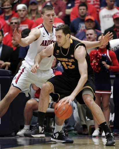 No. 18 Arizona rolls past Arizona State 73-58