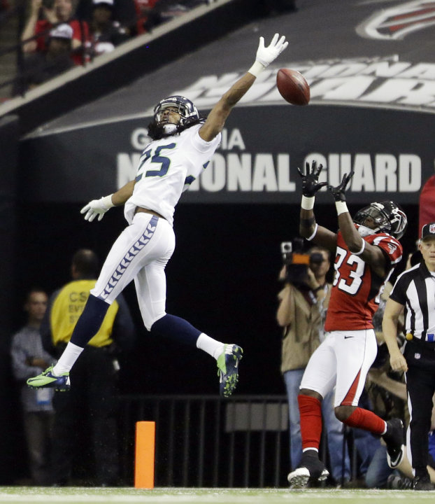 Seattle Seahawks cornerback Richard Sherman (25) breaks up a pass intended Atlanta Falcons wide receiver Harry Douglas (83) during the second half of an NFC divisional playoff NFL football game Sunday