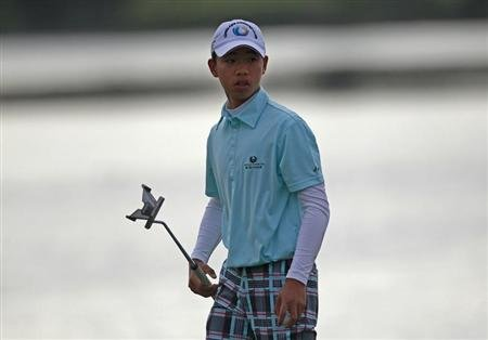 Chinese golfer Guan walks during the Australian Open golf tournament in Sydney