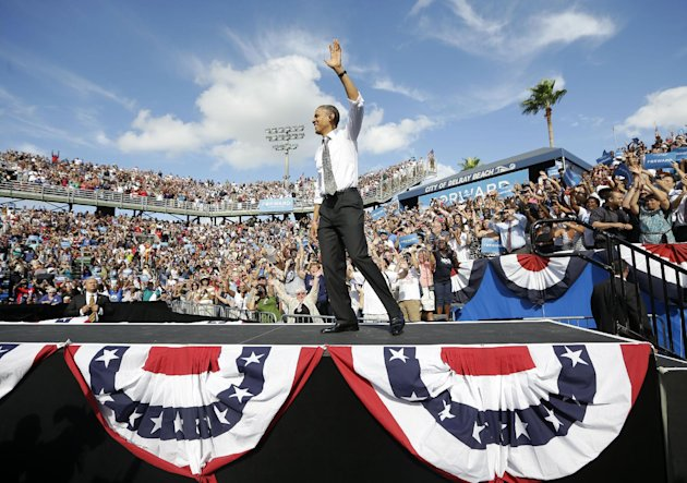 President Barack Obama waves as takes the stage at a campaign event at Delray Beach Tennis Center, Tuesday, Oct. 23, 2012 in Delray Beach, Fla., the day after the last presidential debate against Republican Presidential candidate, former Massachusetts Gov. Mitt Romney. The president is making campaign stops in Florida and Ohio today. (AP Photo/Pablo Martinez Monsivais)