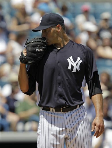 Pettitte pitches inning in Yankees' win