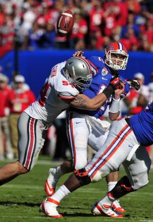 Florida quarterback John Brantley (12) is sacked by Ohio State defensive tackle John Simon (54) during the first half of the Gator Bowl NCAA college football game, Monday, Jan. 2, 2012, in Jacksonville, Fla. (AP Photo/Stephen Morton)