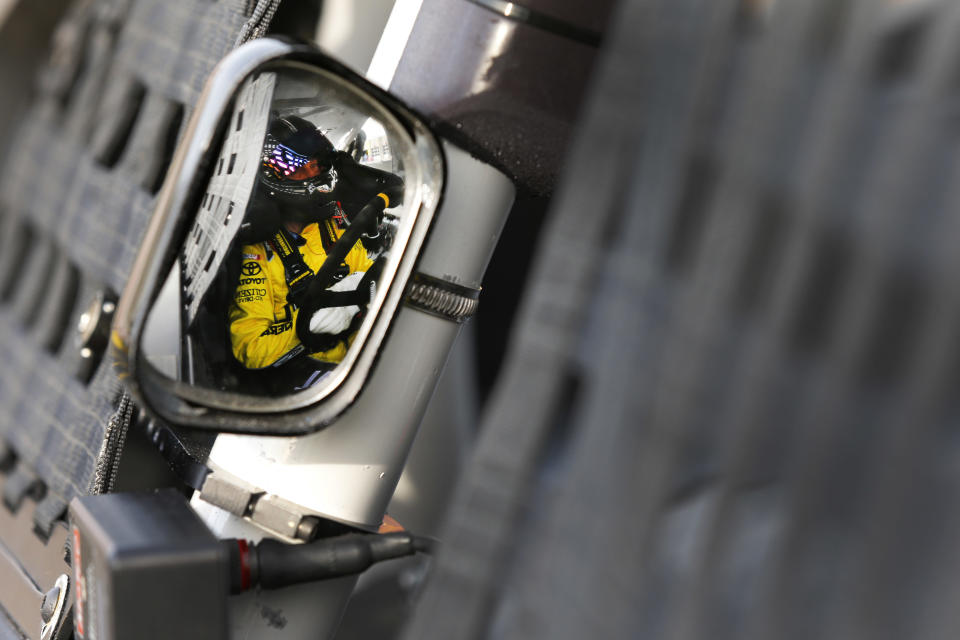 Matt Kenseth sits in his car before testing for the NASCAR Sprint Cup auto racing series at Charlotte Motor Speedway in Concord, N.C., Tuesday, Dec. 11, 2012. (AP Photo/Chuck Burton)