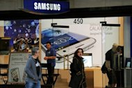 This file photo shows a Samsung store in Sydney, pictured in August. South Korea&#39;s Samsung Electronics said on Friday it expected a record operating profit of 8.1 trillion won ($7.3 billion) in the third quarter, boosted by sales of its flagship Galaxy smartphones