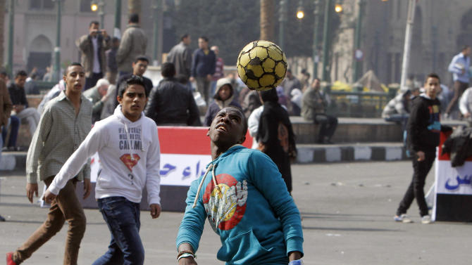 Egyptians play soccer in Tahrir Square prior to planned events to mark the second anniversary of former President Hosni Mubarak's resignation, in Cairo, Egypt, Monday, Feb. 11, 2013. Egypt has witnessed a fresh cycle of violence over the past weeks since the second anniversary of the 2011 uprising that deposed longtime autocrat Hosni Mubarak, with clashes across the country having left scores dead and hundreds injured. (AP Photo/Amr Nabil)