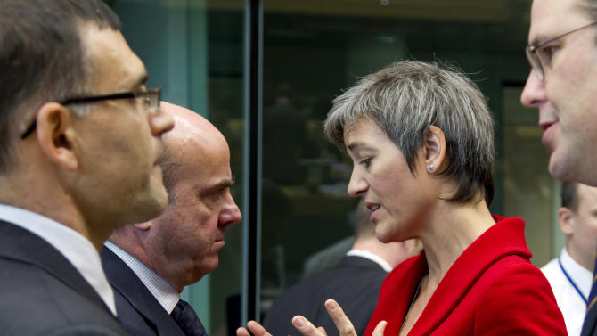 Denmark's Economy Minister Margrethe Vestager, second right, speaks with Spain's Economy Minister Luis de Guindos, second left, during a meeting of EU finance ministers in Brussels on Wednesday, Dec. 12, 2012. European Union finance ministers on Wednesday sought to agree on the creation of a single supervisor for banks across the 27-country bloc after France and Germany apparently patched up their differences over the issue. (AP Photo/Virginia Mayo)
