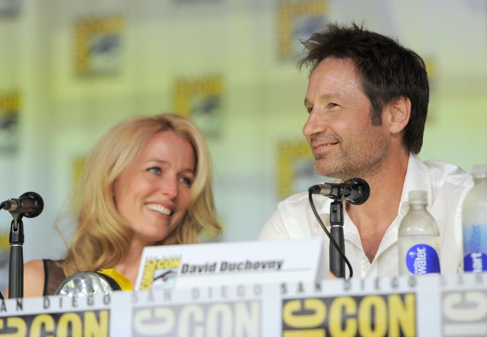 "Gillian Anderson, left, and David Duchovny, attend the ""The X Files"" 20th Anniversary panel on Day 2 of Comic-Con International on Thursday, July 18, 2013 in San Diego, Calif. (Photo by Chris Pizzello/Invision/AP)"
