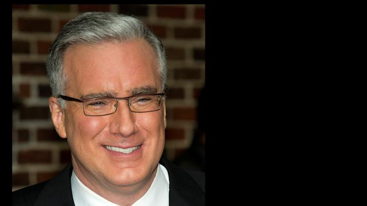 "FILE - In this Oct. 24, 2011 file photo, political pundit Keith Olbermann leaves a taping of the ""Late Show with David Letterman,"" in New York. Olbermann sued his former bosses at Current TV in Los Angeles on Thursday, seeking more than $50 million for breach of contract and other claims. His case claims his show for the network was fraught with technical problems and he was fired without cause. (AP Photo/Charles Sykes, file)"