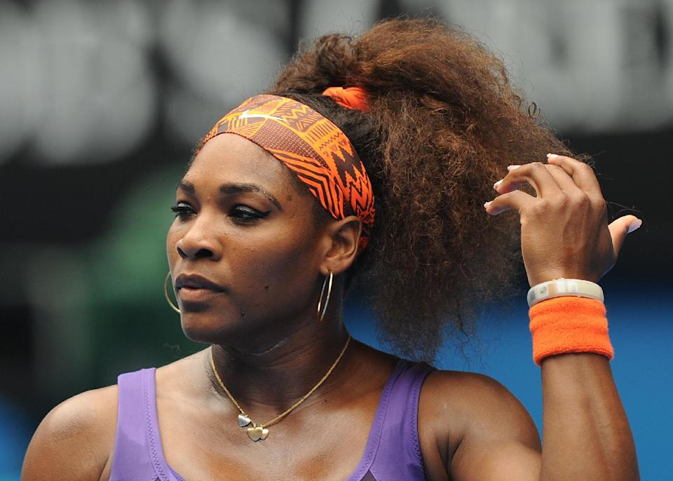 Serena Williams of the US waits to during her second round match against Spain's Garbine Muguruza at the Australian Open tennis championship in Melbourne, Australia, Thursday, Jan. 17, 2013. (AP Photo/Andrew Brownbill)