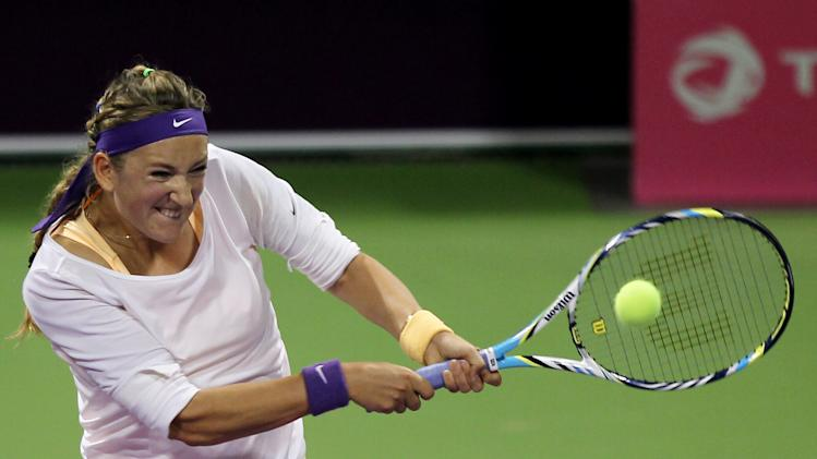 Belarus' Victoria Azarenka returns the ball to Sara Errani of Italy in the quarterfinal of the WTA Qatar Ladies Open tennis tournament in Doha, Qatar, Friday, Feb. 15, 2013. (AP Photo/Osama Faisal)