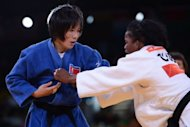 "North Korea's An Kum-Ae during her women's -52kg judo final against Cuba's Yanet Bermoy Acosta at the London Olympics on July 29. ""She owes her success to the great leaders, the benevolent social system and the (ruling) Workers' Party of Korea,"" An's father An Jong-Ryon was quoted as saying"