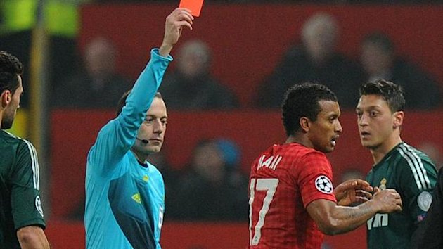 Nani, second right, was sent off by referee Cuneyt Cakir, left, following a high tackle
