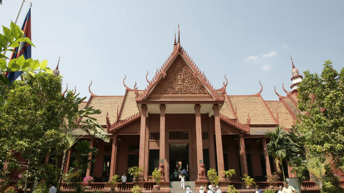 In this Wednesday, Feb. 27, 2013,  foreign tourists enter a museum, in Phnom Penh, Cambodia. Phnom Penh's developing tourism sector also means that nearly every attraction has an entry fee, even if just a dollar or two. But in keeping with history, some sites cost nothing at all. (AP Photo/Heng Sinith)