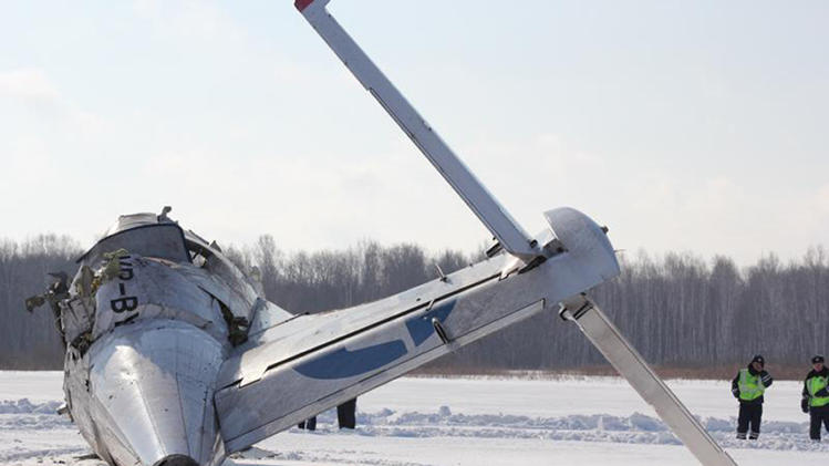Officers guard the site of the atr-72 plane crash outside tyumen