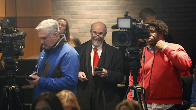 Joel Brodsky, former lead defense attorney for Drew Peterson, center, listens to a news conference by Will County States Attorney James W. Glasgow shortly after Judge Edward Burmila sentenced Peterson to 38 years in prison for the 2004 murder of his third wife Kathleen Savio Thursday, Feb. 21, 2013, in Joliet, Ill. Peterson's current legal team had argued for a new trial on grounds that Brodsky botched the case but Judge Burmila rejected the motion. (AP Photo/Charles Rex Arbogast)