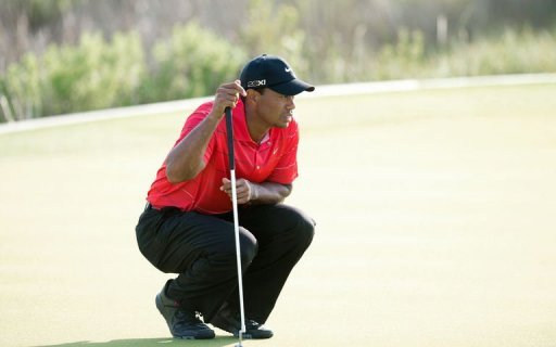 Tiger Woods of the US lines up a putt