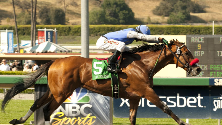 In this photo provided by Benoit Photo, Goldencents and Kevin Krigger race to win the Grade I $750,000 Santa Anita Derby horse race on Saturday, April 6, 2013 at Santa Anita Park in Arcadia, Calif. (AP Photo/Benoit Photo)