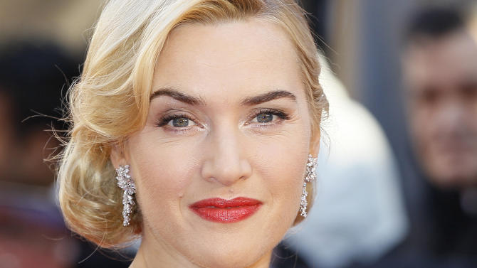 British actress Kate Winslet arrives at the World Premiere of Titanic 3D at the Royal Albert Hall in London, Tuesday, March, 27, 2012. (AP Photo/Alastair Grant)
