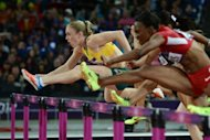 Australia&#39;s Sally Pearson (L) competes in the women&#39;s 100m hurdles final at the athletics event during the London 2012 Olympic Games on August 7, 2012 in London. Pearson clocked an Olympic record of 12.35sec