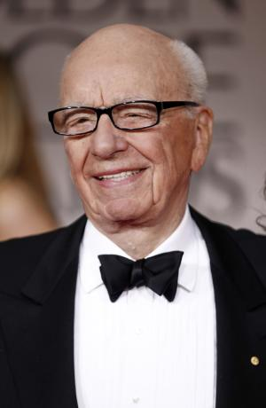 FILE - In this Jan. 15, 2012 file photo Rupert Murdoch arrives at the 69th Annual Golden Globe Awards in Los Angeles. Murdoch's News Corp., the global media conglomerate under fire for phone hacking and alleged bribery in Britain, posted a 47 percent increase in third-quarter net income thanks to strong performances at its U.S. pay-TV networks and movie studio   (AP Photo/Matt Sayles, file)