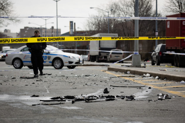 Debris from a fatal accident that claimed the lives of two expectant parents litter Kent Avenue, Sunday, March 3, 2013, in the Brooklyn borough of New York. A driver struck the car the couple were rid