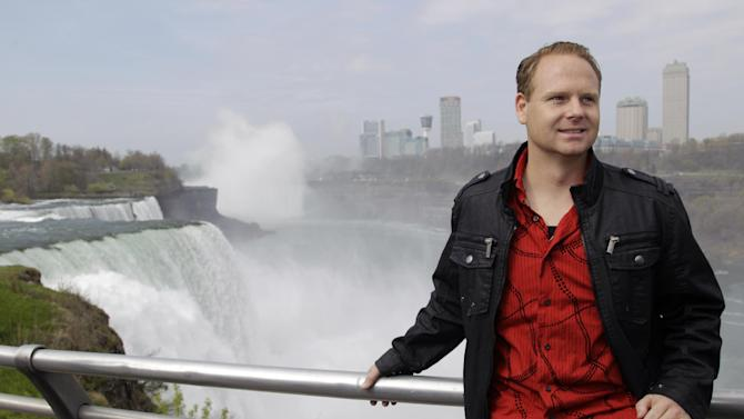 Nik Wallenda poses for photos after a news conference in Niagara Falls, N.Y., Wednesday, May 2, 2012. Wallenda will try to cross the Niagara Gorge on a tightrope June 15. The seventh-generation member of the Flying Wallendas spent months getting the necessary permissions from Canada and the United States for the cross-border stunt. (AP Photo/David Duprey)